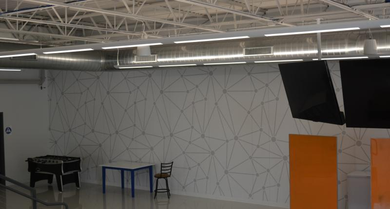 Network mural on wall, large whiteboards, and open space