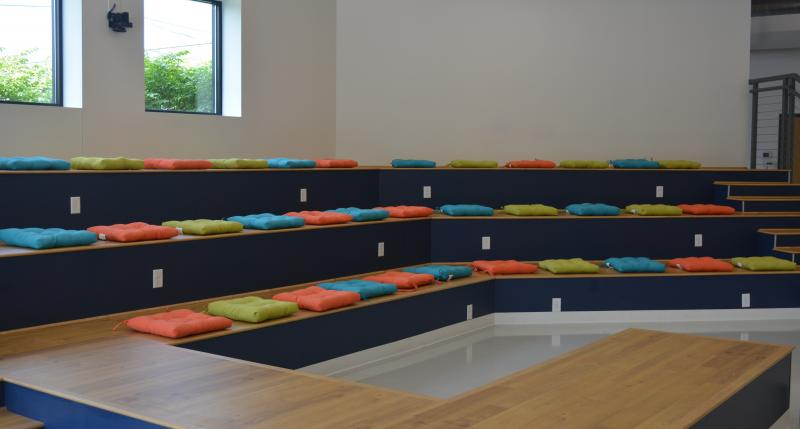 Risers with colored pillows